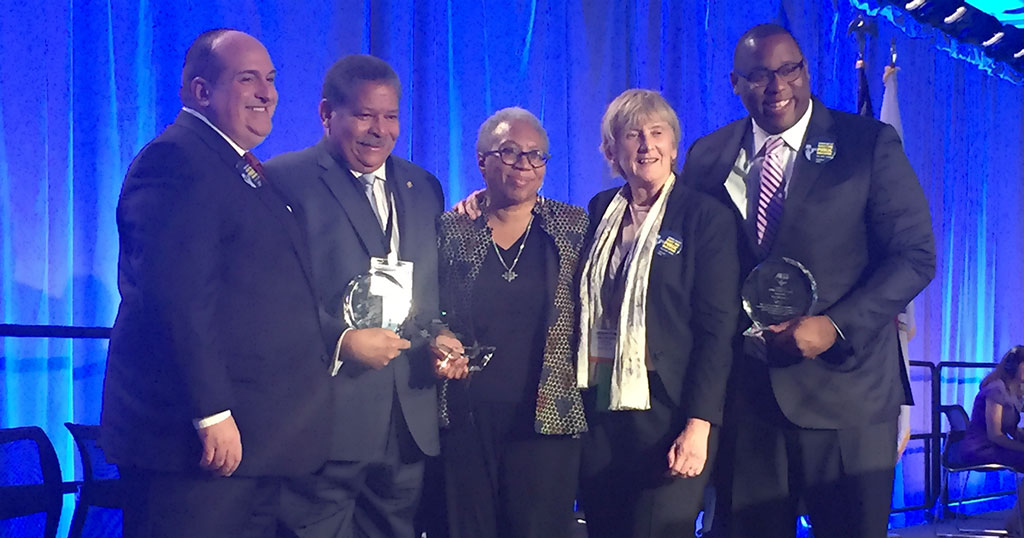 Vice President Erik J. Champy and President Barbara Madeloni congratulated, from left, Friend of Labor Juan Cofield, President's Award winner Donna Bivens and Friend of Education Tito Jackson.