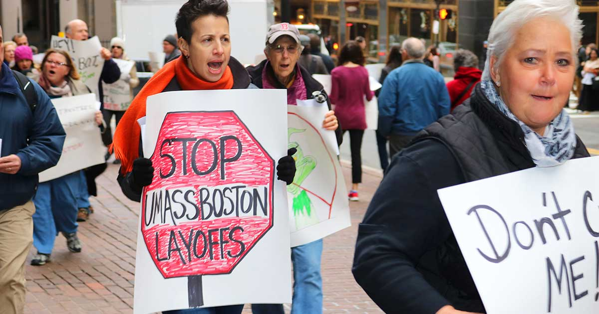 UMass Boston students, staff and faculty marched outside a UMass Board of Trustees finance committee meeting in downtown Boston. The crowd protested layoffs and deep budget cuts.