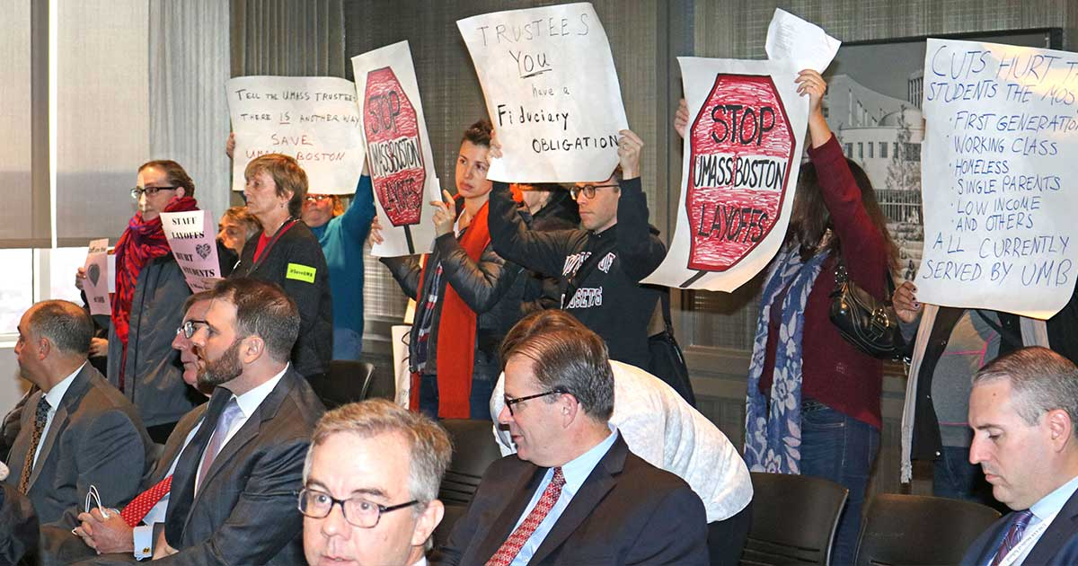 Demonstrators inside the meeting of the UMass Board of Trustees finance committee demanded a response to their request that the board use $5 million from a $96 million unrestricted reserve fund to save jobs and programs.