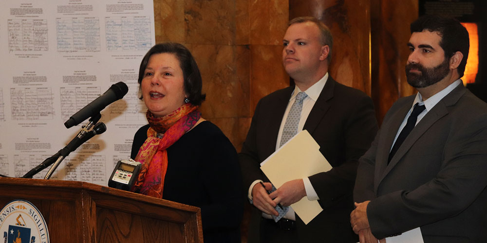 The CHERISH Act's lead sponsors, Senator Jo Comerford and Representatives Sean Garballey and Paul Mark, from left to right, spoke to a crowd gathered at the State House