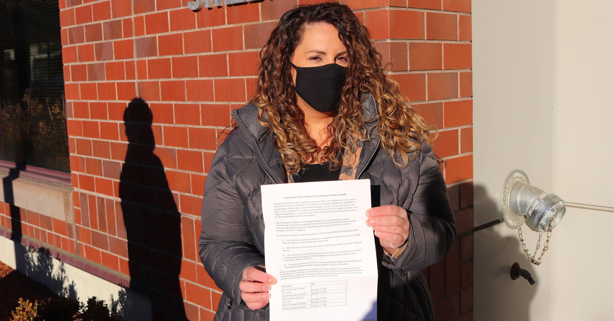 Malden Education Association President Deborah Gesualdo with the petition.